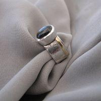 black star sapphire cabochon ring
